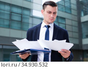 Financial director is examining documents before signing. Стоковое фото, фотограф Яков Филимонов / Фотобанк Лори