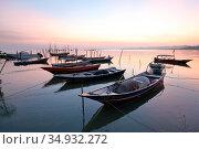 Sunrise at Buntal Fishing Village and Small fishing boats, kuching... Стоковое фото, фотограф Chew Chun Hian / age Fotostock / Фотобанк Лори