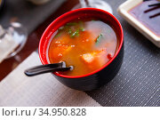 Spicy asian tomato soup in red bowl. Стоковое фото, фотограф Яков Филимонов / Фотобанк Лори