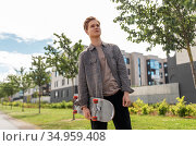 teenage boy with skateboard on city street. Стоковое фото, фотограф Syda Productions / Фотобанк Лори
