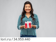 happy asian woman with birthday or christmas gift. Стоковое фото, фотограф Syda Productions / Фотобанк Лори