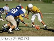 Junior varsity high school football action - the ball is fumbled ... (2004 год). Редакционное фото, фотограф Dennis MacDonald / age Fotostock / Фотобанк Лори