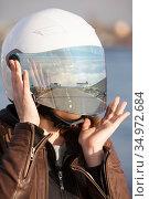 Portrait of unrecognizable European female motorcyclist with road reflection in her mirrored tinted visor of a helmet, collage. Стоковое фото, фотограф Кекяляйнен Андрей / Фотобанк Лори