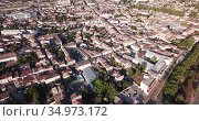 Aerial view of summer cityscape of small French town of Marmande overlooking Gothic building of Our Lady Church. Стоковое видео, видеограф Яков Филимонов / Фотобанк Лори