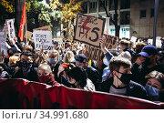 Warsaw, Poland - October 26, 2020: People with anti-government plackards... Редакционное фото, фотограф Konrad Zelazowski / age Fotostock / Фотобанк Лори