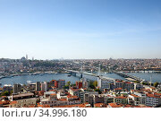 Skyline of Istanbul, as seen from Galata Turm. View of the Golden Horn Metro Bridge and Ataturk Bridge. City of Istanbul, Turkey. Стоковое фото, фотограф Bala-Kate / Фотобанк Лори