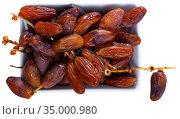 Fresh dates on white background, healthy snack. Стоковое фото, фотограф Яков Филимонов / Фотобанк Лори
