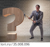 Angry man with axe axing the question mark. Стоковое фото, фотограф Elnur / Фотобанк Лори
