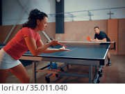 Table tennis, male and female ping pong players. Стоковое фото, фотограф Tryapitsyn Sergiy / Фотобанк Лори