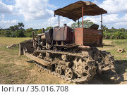 Caterpillar on a farm. Cuba. Стоковое фото, фотограф Andre Maslennikov / age Fotostock / Фотобанк Лори