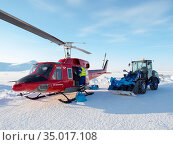 Helicopter on helipad. During winter the helicopter is the only link... Редакционное фото, фотограф Martin Zwick / age Fotostock / Фотобанк Лори