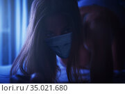 Woman in the bedroom with a medical disposable mask. Стоковое фото, фотограф Jan Jack Russo Media / Фотобанк Лори