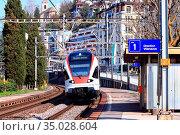 The Modern Local Train in Montreux. Стоковое фото, фотограф Vichaya Kiatying-Angsulee / easy Fotostock / Фотобанк Лори