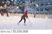 happy woman at outdoor skating rink in winter. Стоковое фото, фотограф Syda Productions / Фотобанк Лори