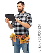 builder with tablet computer and tools. Стоковое фото, фотограф Syda Productions / Фотобанк Лори