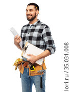 male builder with clipboard and blueprint. Стоковое фото, фотограф Syda Productions / Фотобанк Лори