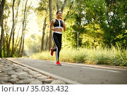 Morning training in park, woman running on walkway. Стоковое фото, фотограф Tryapitsyn Sergiy / Фотобанк Лори