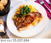 Steak of beef sirloin with fried potatoes and baked jalapenos. Стоковое фото, фотограф Яков Филимонов / Фотобанк Лори