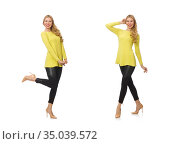 Pretty young woman in yellow blouse isolated on white. Стоковое фото, фотограф Elnur / Фотобанк Лори