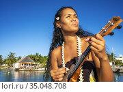 Beautiful local woman playing ukulele in Rangiroa beach, Tuamotu ... Редакционное фото, фотограф Sergi Reboredo / age Fotostock / Фотобанк Лори