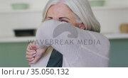 Portrait of senior caucasian woman coughing or sneezing into her arm. Стоковое видео, агентство Wavebreak Media / Фотобанк Лори