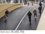 Stockholm, Sweden 27 October, 2020 Bicyclists on the new Slussbron... Редакционное фото, фотограф A. Farnsworth / age Fotostock / Фотобанк Лори