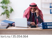 Male arab bookkeeper extremely tired with an excessive work. Стоковое фото, фотограф Elnur / Фотобанк Лори
