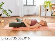 happy pregnant woman doing yoga at home. Стоковое фото, фотограф Syda Productions / Фотобанк Лори