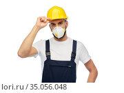 male worker or builder in helmet and respirator. Стоковое фото, фотограф Syda Productions / Фотобанк Лори