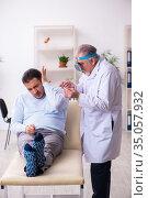Young sick man visiting old doctor otolaryngologist. Стоковое фото, фотограф Elnur / Фотобанк Лори