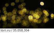 Multiple yellow fairy lights glowing on black background. Стоковое видео, агентство Wavebreak Media / Фотобанк Лори