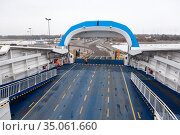 Empty ferryboat Toll by Praamid is ready for departure at winter. Route from Virtsu mainland to Kuivastu. TS Laevad is an Estonian company operates two routes in Baltic Sea. Estonia (2018 год). Редакционное фото, фотограф Кекяляйнен Андрей / Фотобанк Лори
