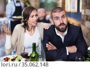 Quarreled visitors female and male in restaurant. Стоковое фото, фотограф Яков Филимонов / Фотобанк Лори