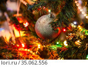 Silver ball and colorful lights on Christmas tree. Стоковое фото, фотограф Юлия Бабкина / Фотобанк Лори