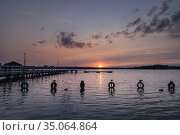 Sunset over Narie Lake located in Ilawa Lakeland region, view from... Стоковое фото, фотограф Konrad Zelazowski / age Fotostock / Фотобанк Лори