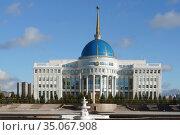 Ak Orda Presidential Palace against blue sky with clouds in late autumn. Nur Sultan. Редакционное фото, фотограф Валерия Попова / Фотобанк Лори