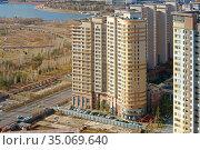 Modern New District Highvill on background of Presidential Park on Ishim River banks. Nur Sultan. Редакционное фото, фотограф Валерия Попова / Фотобанк Лори