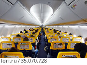 Schoenefeld, Germany, People in a Ryanair aircraft cabin (2019 год). Редакционное фото, агентство Caro Photoagency / Фотобанк Лори