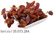 Natural dried fruits of date palm in bowl. Стоковое фото, фотограф Яков Филимонов / Фотобанк Лори