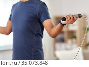 man exercising with jump rope at home. Стоковое фото, фотограф Syda Productions / Фотобанк Лори