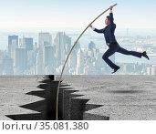 Businessman in pole vaulting concept. Стоковое фото, фотограф Elnur / Фотобанк Лори
