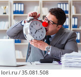 Clown businessman with alarm clock missing dieadline. Стоковое фото, фотограф Elnur / Фотобанк Лори