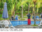 Swimming pool at Virgo Batik Resort, Teluk Batik Beach, Perak, Malaysia... (2017 год). Редакционное фото, фотограф Ian Cook / age Fotostock / Фотобанк Лори