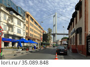 View of Bosphorus bridge, seen from Muallim Naci street. Ortakoy neighborhood, Besiktas district, city of Istanbul, Turkey. Редакционное фото, фотограф Bala-Kate / Фотобанк Лори