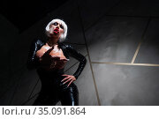 Sexy woman in a blonde wig and latex catsuit. Girl with big fake tits. Стоковое фото, фотограф Михаил Решетников / Фотобанк Лори