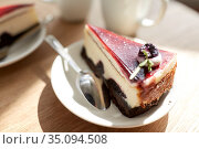 piece of chocolate cake on wooden table. Стоковое фото, фотограф Syda Productions / Фотобанк Лори