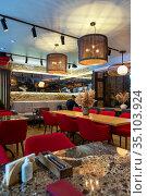 Interior of a modern cozy italian restaurant. Редакционное фото, фотограф Евгений Ткачёв / Фотобанк Лори