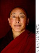 Buddhist monk, portrait. Palpung Monastery, Kham, Dege County, Garze Tibetan Autonomous Prefecture, Sichuan, China. 2016. Стоковое фото, фотограф Enrique Lopez-Tapia / Nature Picture Library / Фотобанк Лори