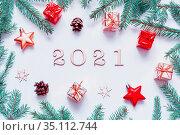 2021 год, новогодний фон. New Year 2021 background with 2021 figures,Christmas toys, fir branches-New Year 2021 composition. Стоковое фото, фотограф Зезелина Марина / Фотобанк Лори