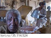 Adwa village or Adua Tigray Region, Ethiopia. Some women sift through... (2020 год). Редакционное фото, фотограф Sergi Reboredo / age Fotostock / Фотобанк Лори